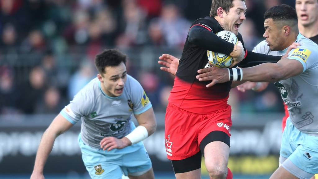 Alex Goode of Saracens holds off Luther Burrell