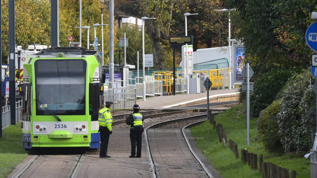 Emergency workers attend the scene of a tram crash
