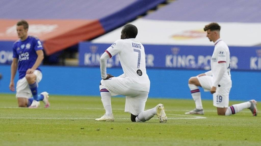 N'Golo Kante of Chelsea (C) takes the knee before the FA Cup quarter-final