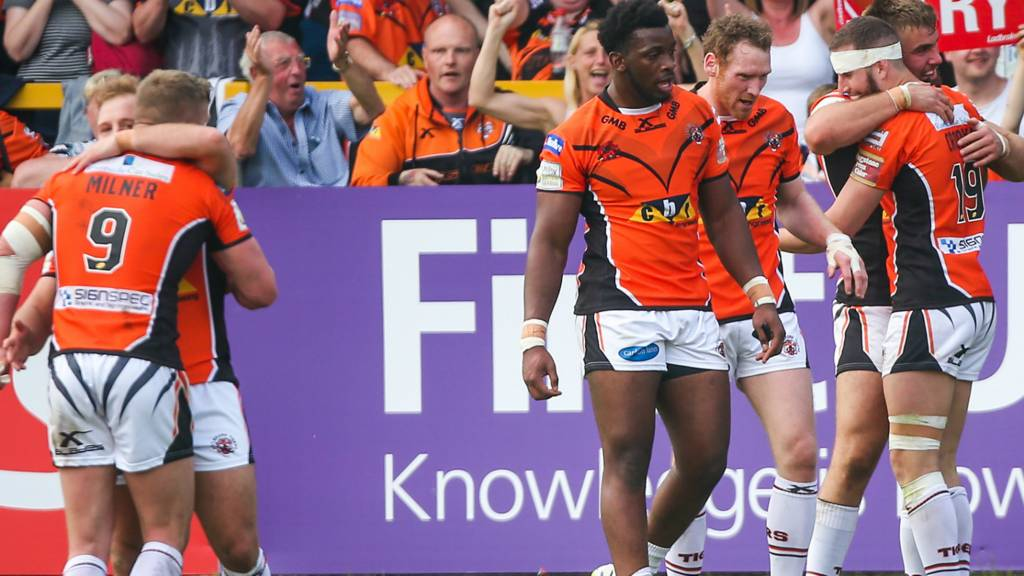 Castleford's players celebrate a try