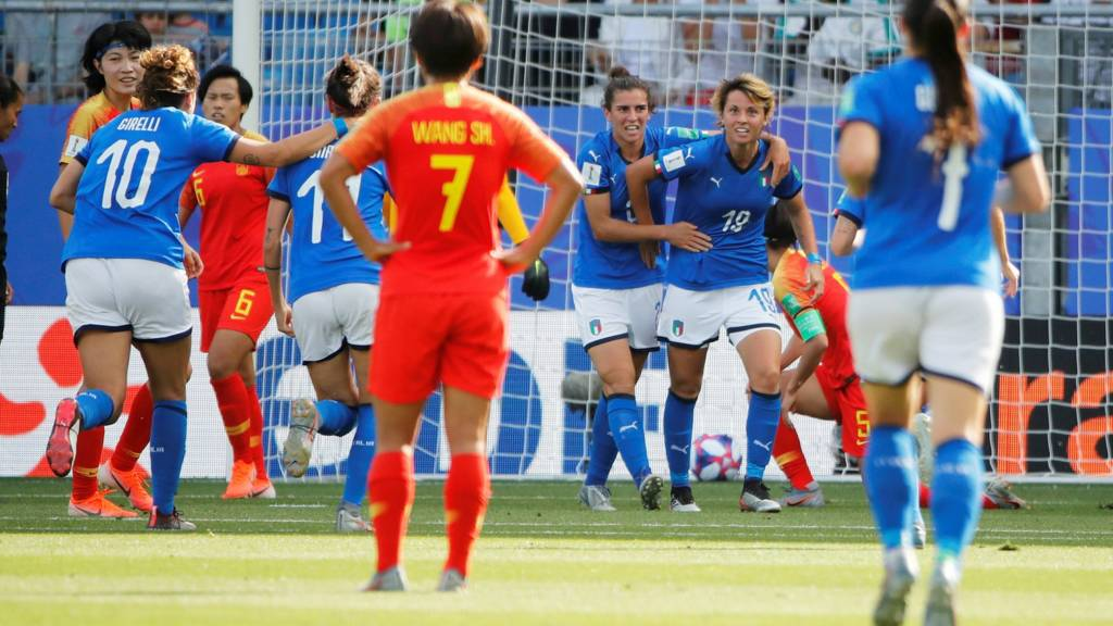 Italy advances by shutting out China, 2-0