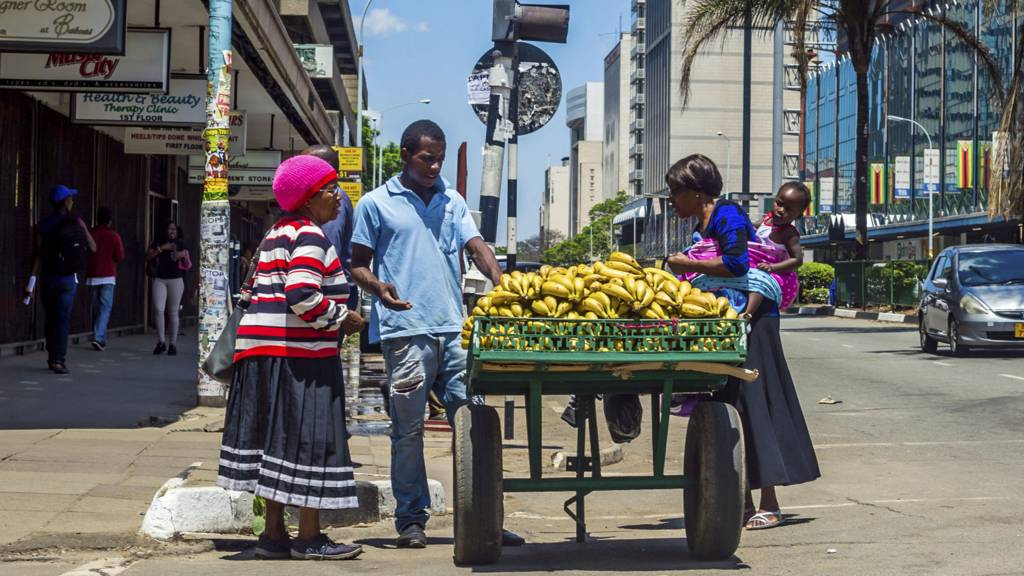 People buying bananas in Harare, Zimbabwe - 2017