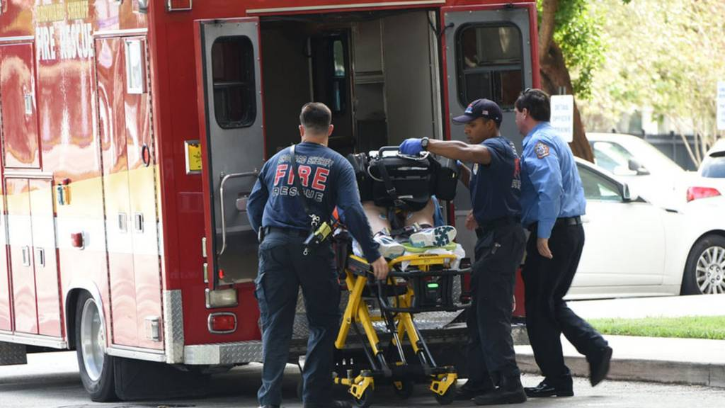 A shooting victim is unloaded from an ambulance and taken into Broward Health Trauma Center in Fort Lauderdale.