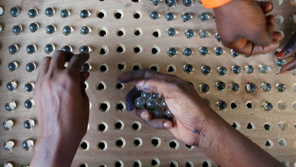 People counting marbles during The Gambia's election