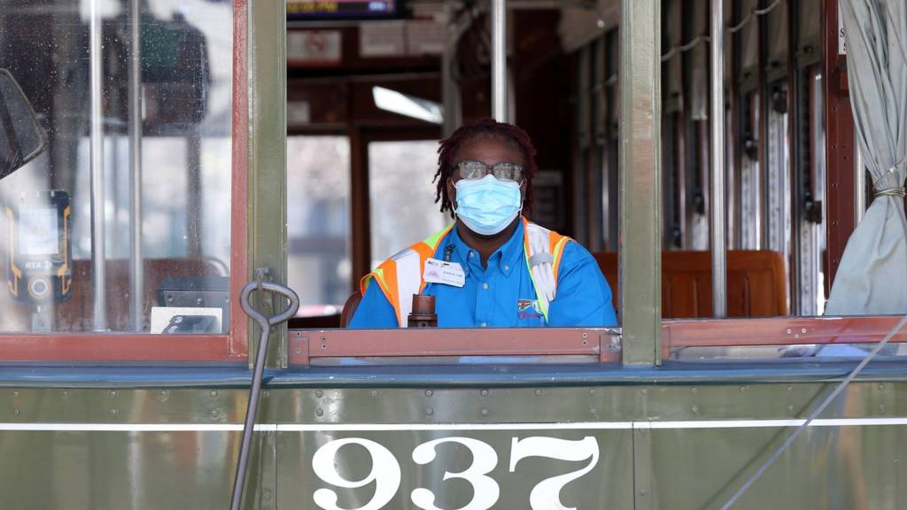 A streetcar worker in the US wears a facemask amid the coronavirus outbreak