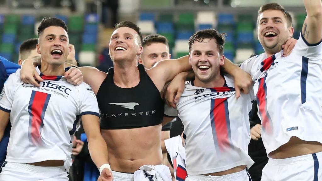 Coleraine players celebrate