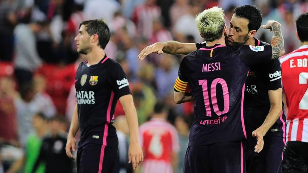 Barcelona's Lionel Messi and Sergio Busquets