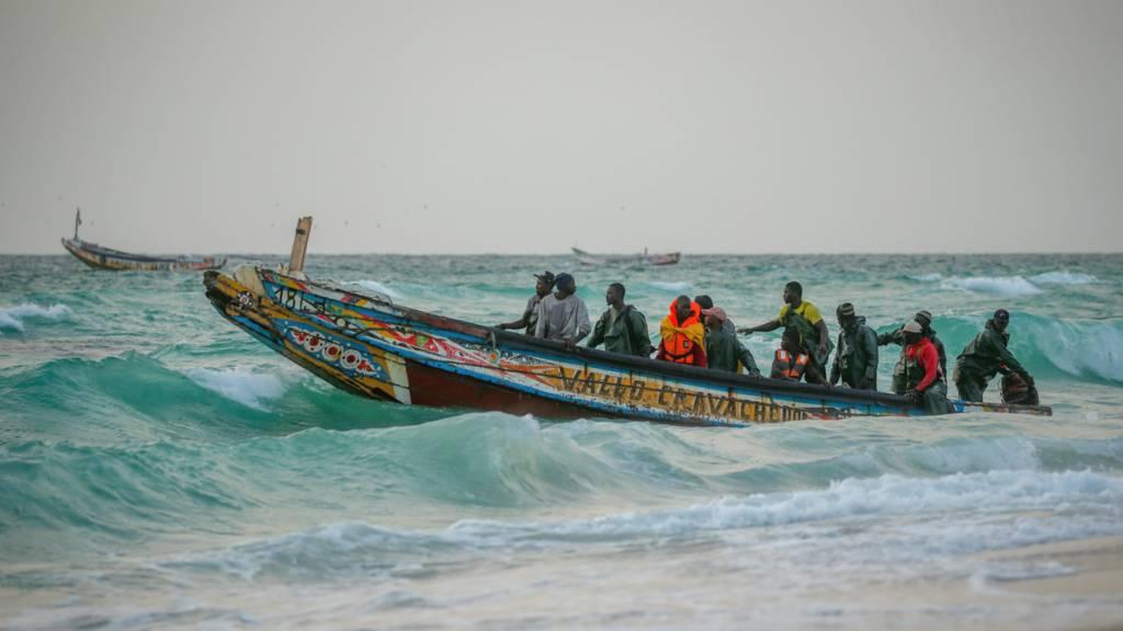 Fishermen in a pirogue off Mauritania