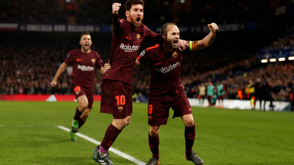 Lionel Messi celebrates scoring their first goal with Andres Iniesta