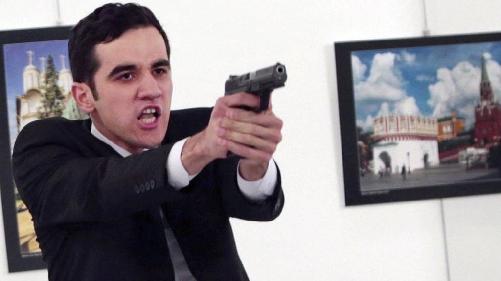 An unnamed gunman gestures after shooting the Russian Ambassador to Turkey, Andrei Karlov, at a photo gallery in Ankara