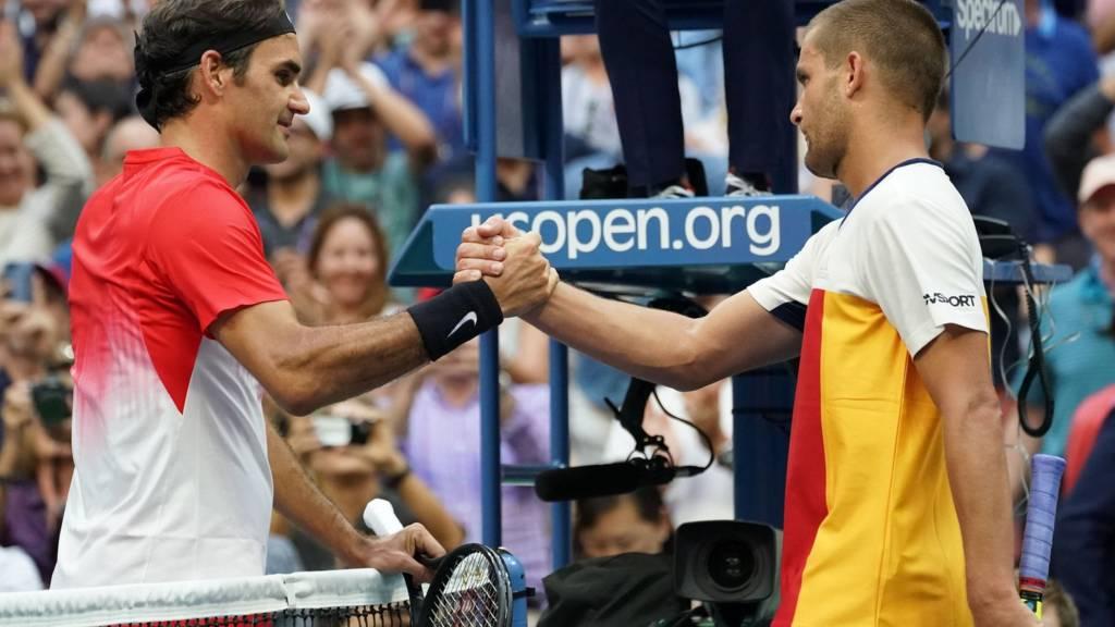 Roger Federer and Mikhail Youzhny