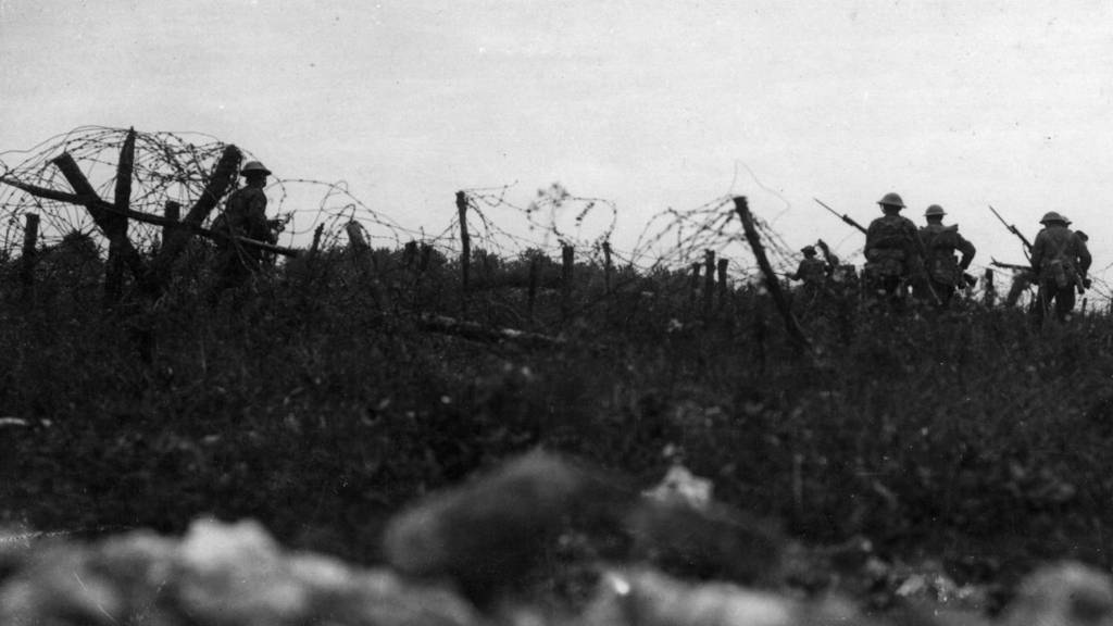 British soldiers move towards the German lines on 1 July 1916 at the Battle of the Somme