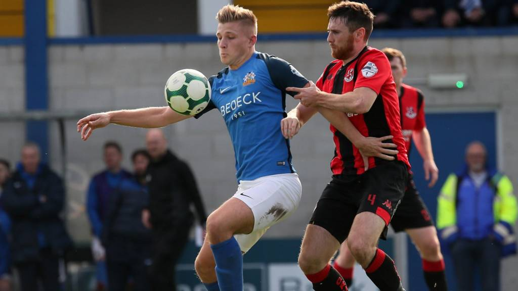 Glenavon striker Andrew Mitchell and Howard Beverland of Crusaders