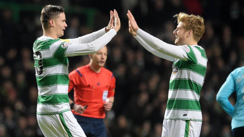 Mikael Lustig celebrates Celtic's opening goal with Stuart Armstrong