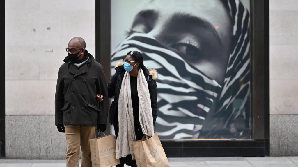 Shoppers wear face masks on Oxford Street, London