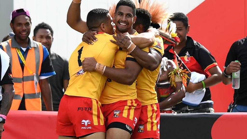 Papua New Guinea's David Mead celebrates scoring a try