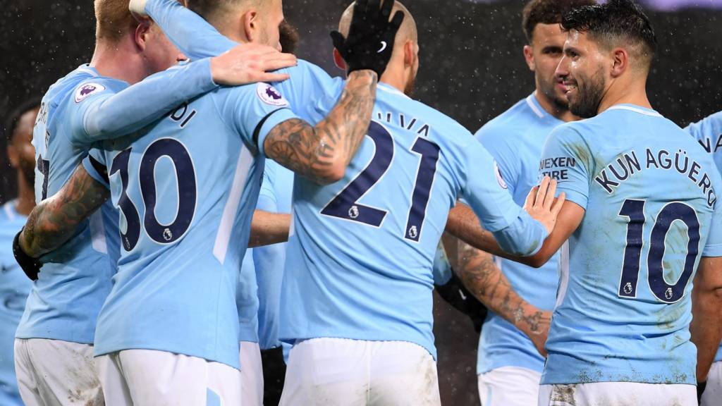 Man City players celebrate a goal