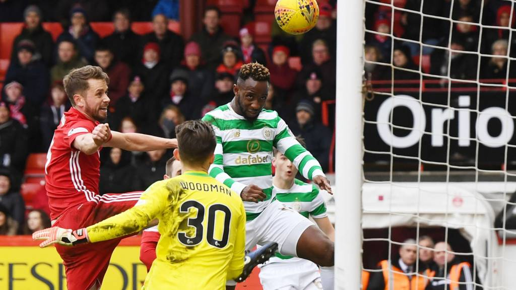 Moussa Dembele heads Celtic in front against Aberdeen