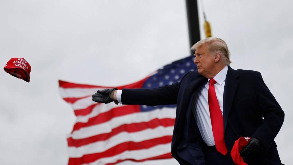 President Trump throws MAGA hat during Michigan campaign