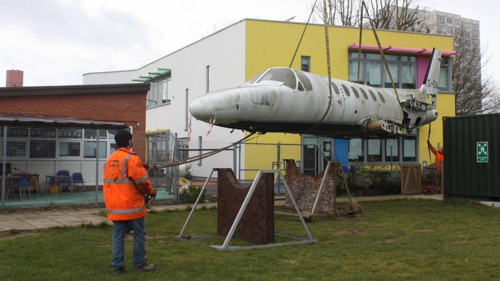 Jet being lifted into position