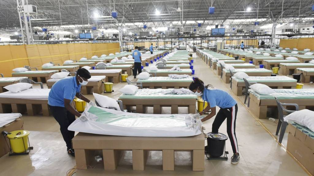 Beds being prepared in a Covid-19 hospital in Delhi