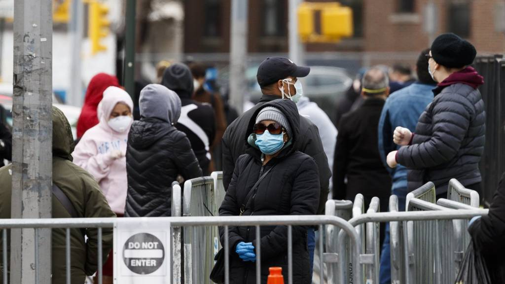 People queue outside a coronavirus testing area in New York