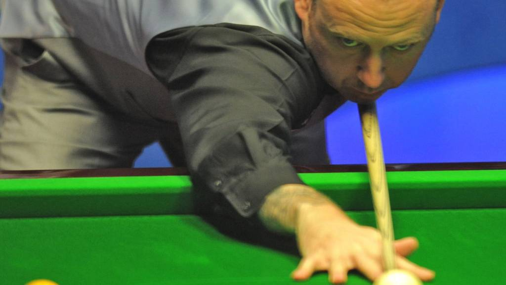 Mark Williams plays a shot