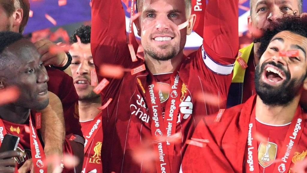 Liverpool lift the Premier League trophy