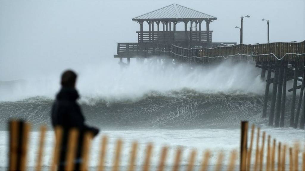 Final calls to evacuate as Florence buffets US East Coast