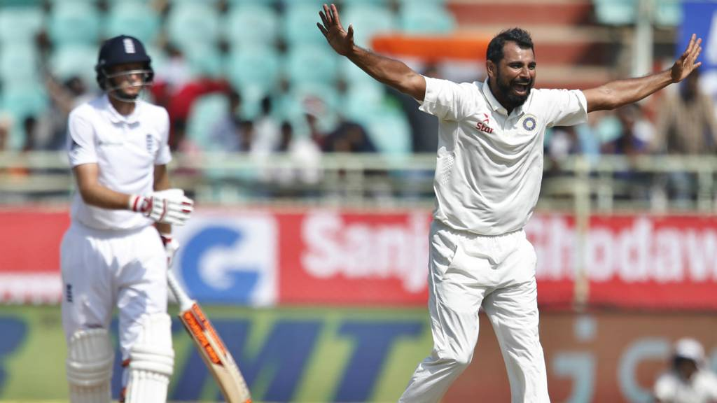India's Shami celebrates the wicket of Joe Root