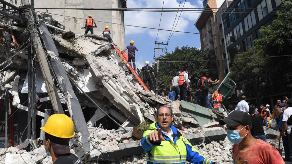 Rescuers search for survivors amid the rubble of a collapsed building in Mexico City on September 19, 2017