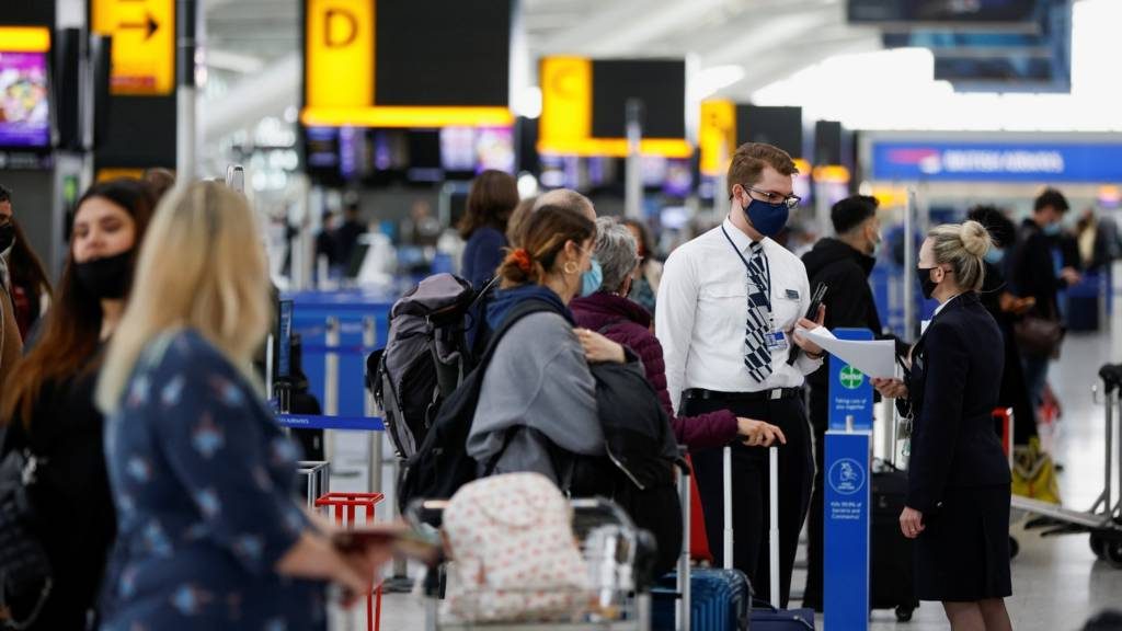 Airline staff and passengers at Heathrow Airport