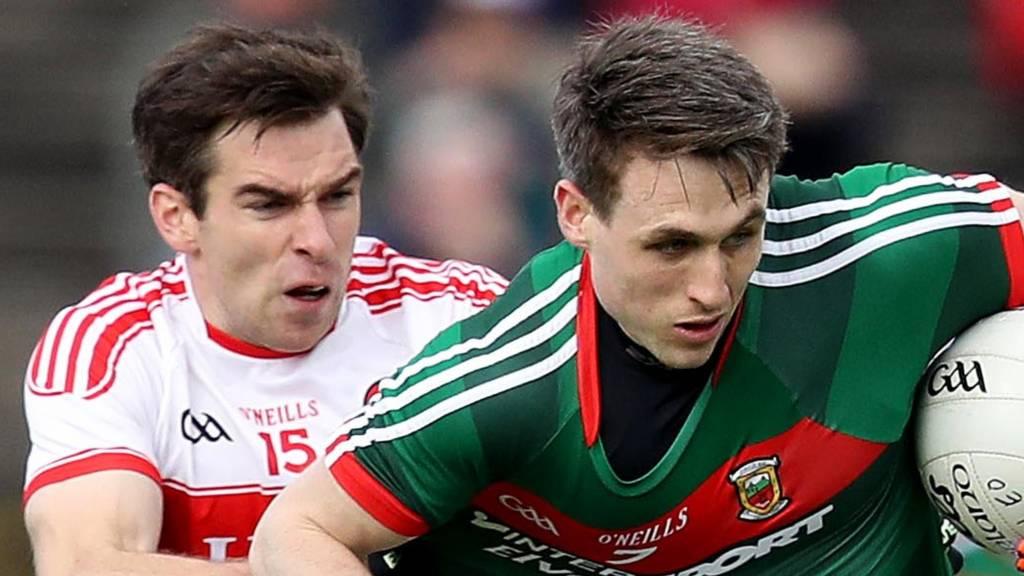 Derry's Benny Heron tackles Mayo's Patrick Durcan