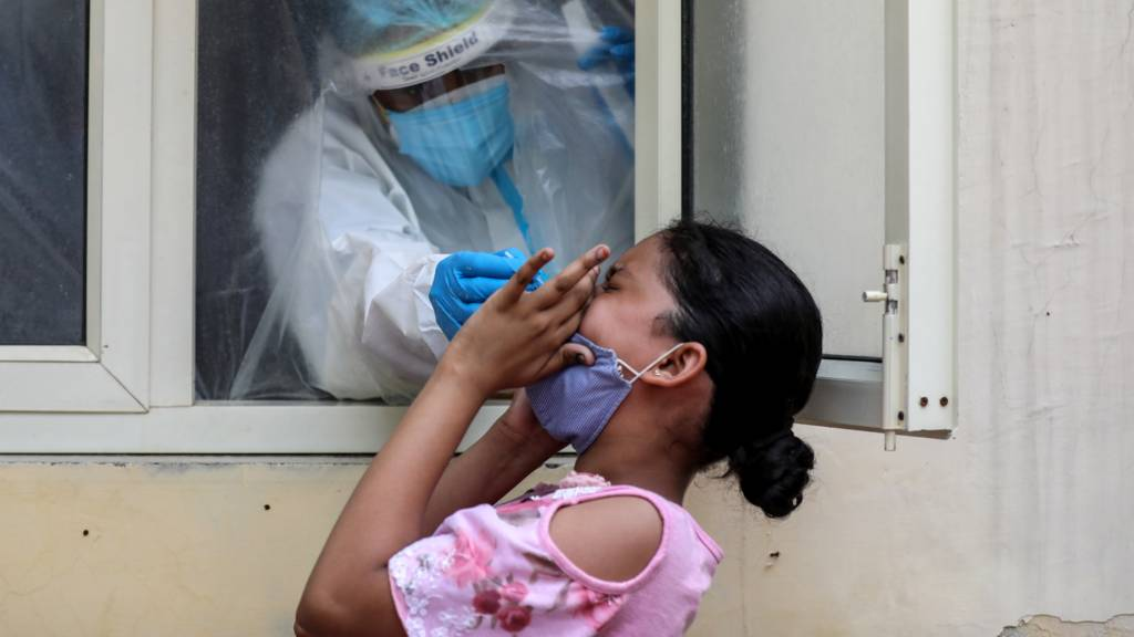 A health worker takes a swab sample for a Covid-19 detection test in New Delhi, India, 9 September 2020