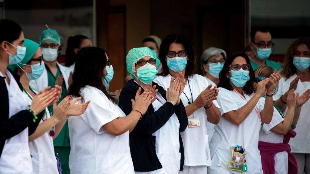 Clapping Spanish health workers