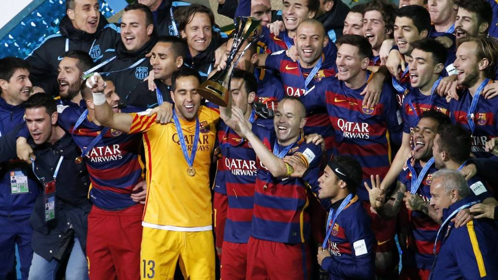 Barcelona players celebrates with the World Club Cup trophy