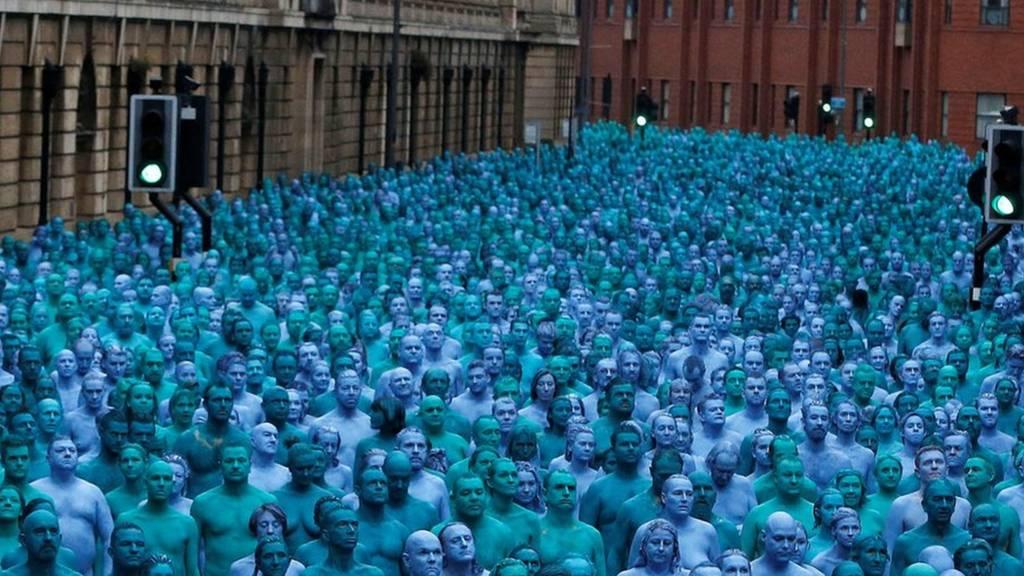 People nude and painted blue standing in Alfred Gelder Street