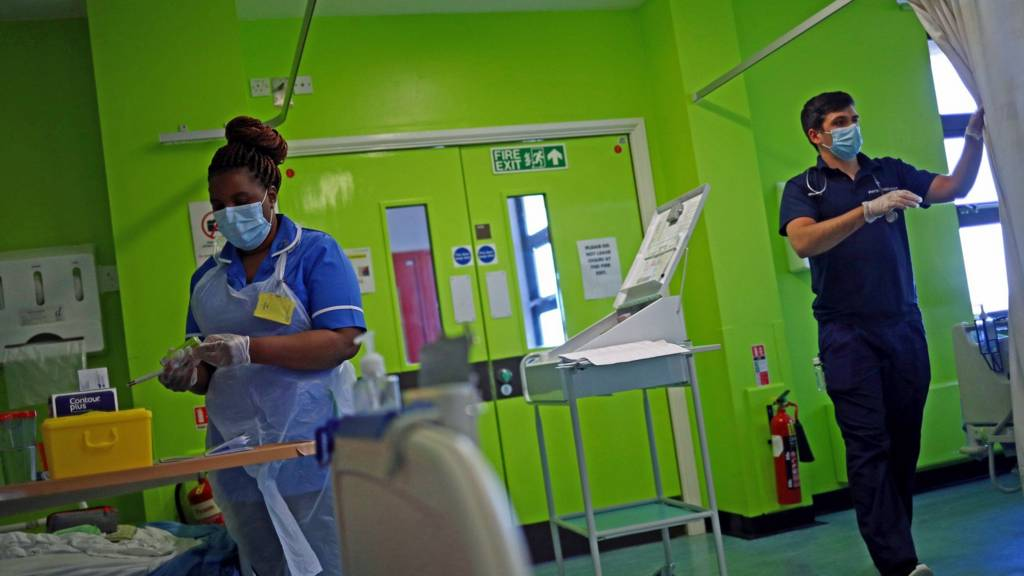 NHS staff treating patients in a hospital