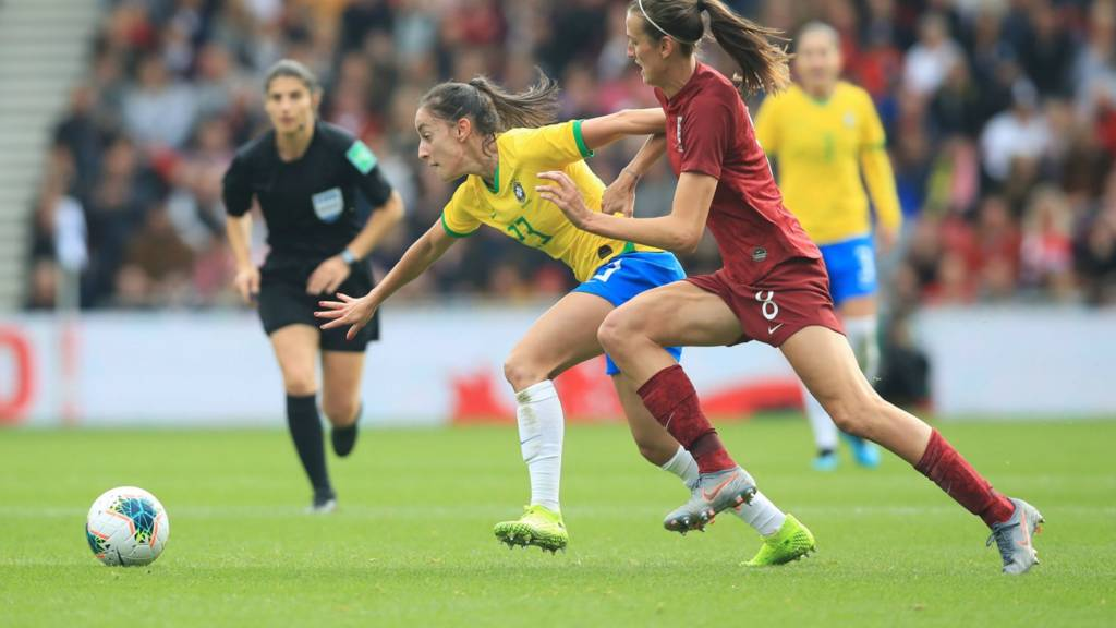 Brazil's Paixao Luana and England's Jill Scott (right) battle for the ball during the International Friendly match at the Riverside Stadium