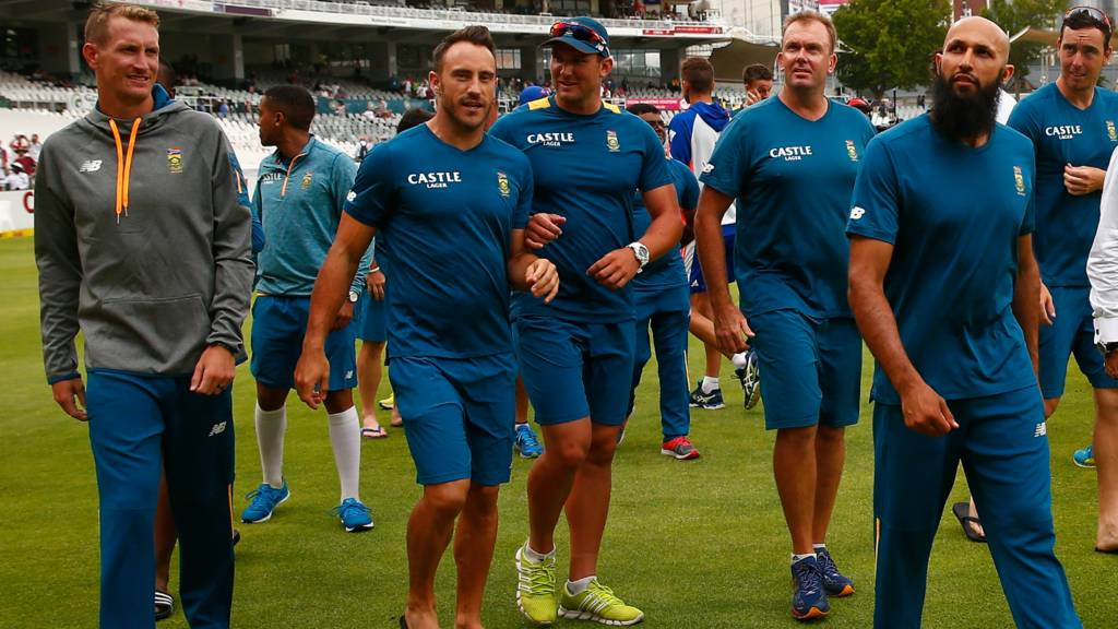 Hashim Amla leads the South African team off