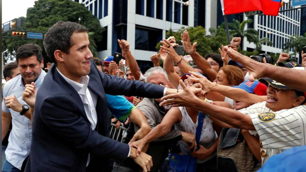 "Venezuela""s National Assembly head Juan Guaidó speaks to the crowd during a mass opposition rally"