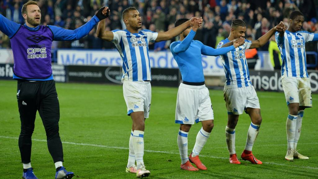 Huddersfield players celebrate victory against Wolves