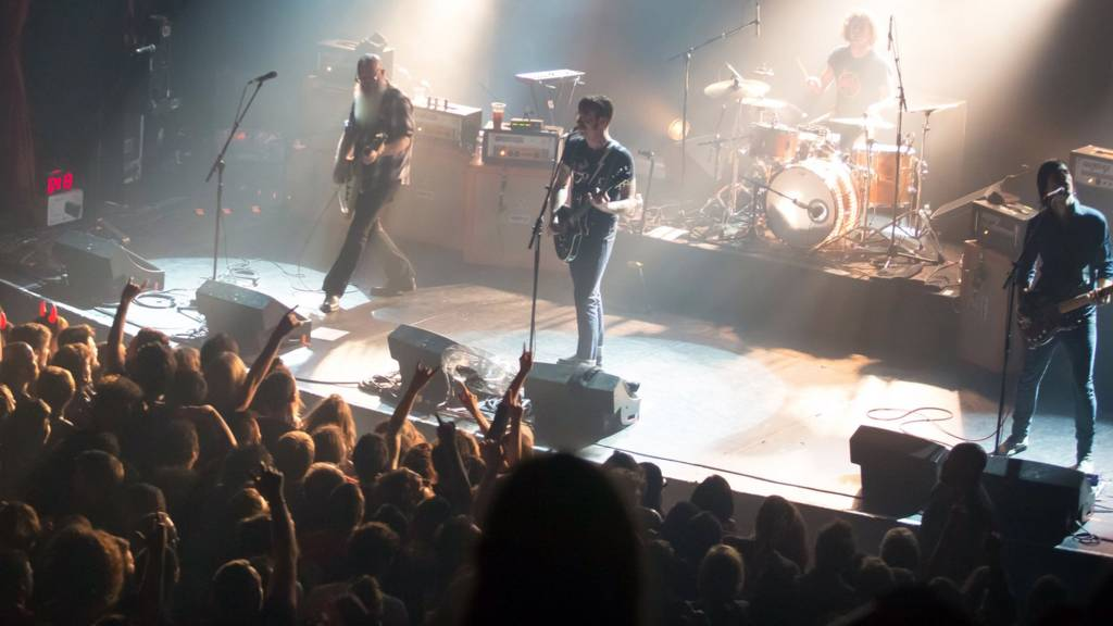 American rock group Eagles of Death Metal perform on stage on November 13, 2015 at the Bataclan concert hall in Paris, few moments before four men armed with assault rifles a stormed into the venue