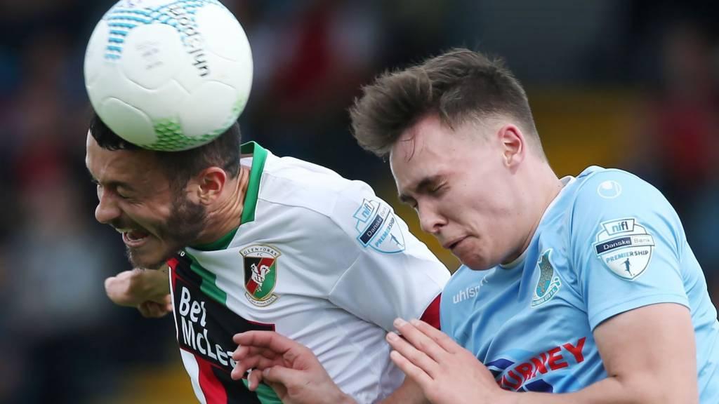 Glentoran's Jonny Frazer and Ballymena United defender Kofi Balmer
