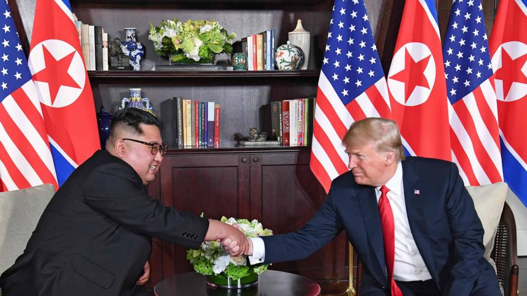 Donald Trump and Kim Jong-un share historic handshake