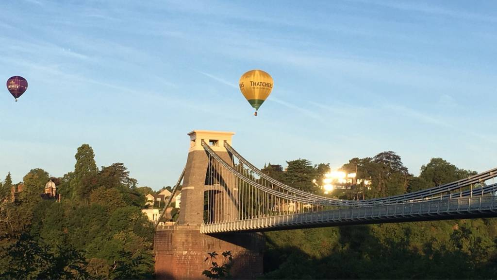 Clifton Suspension Bridge with hot air balloons flying overhead
