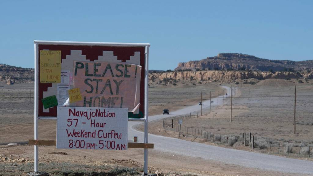 Please stay home sign in Navajo desert