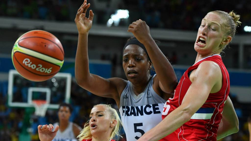 "Danielle Page of Serbia vies with France""s forward Endy Miyem"