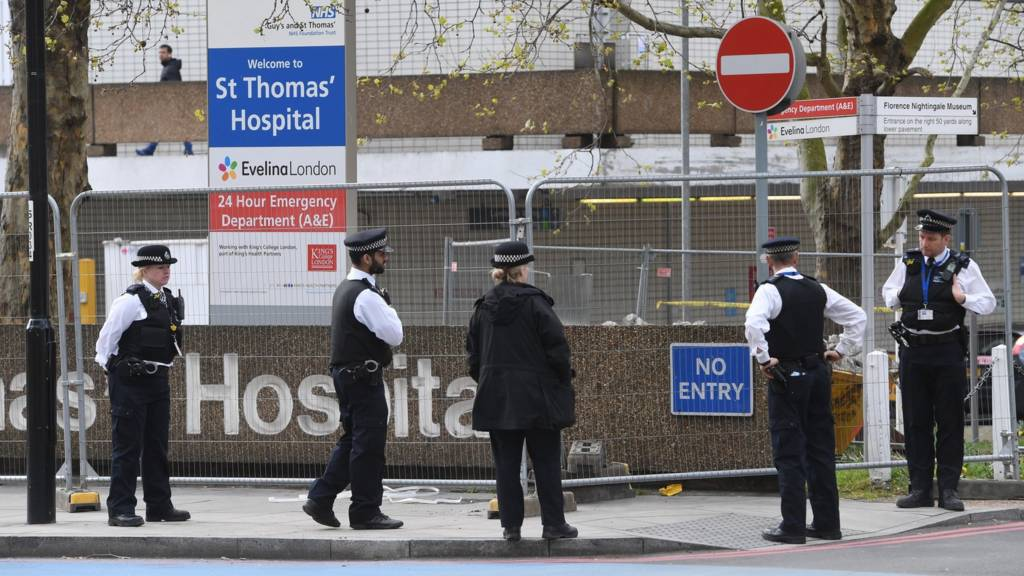 "Police stand guard outside St.Thomas""s Hospital in London, Britain, where Johnson is in intensive care"