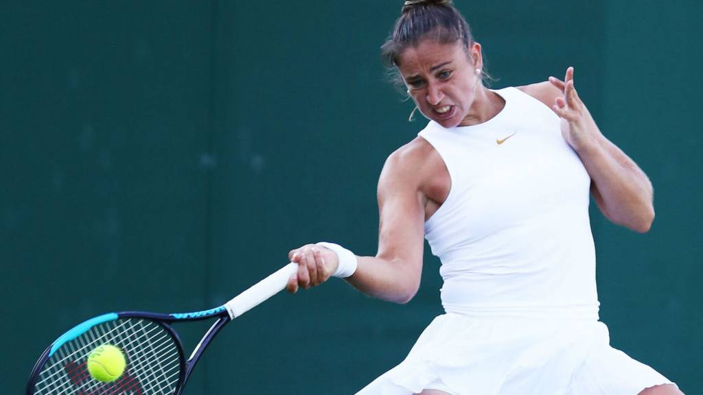 Sad Muguruza joins Wimbledon seed exodus, Halep eases through